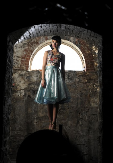Gracia top, $116; Elliott skirt, $148, both from Katwalk Boutique. Melissa heels, $180, Sassanova. Earrings, $165, Amaryllis.
