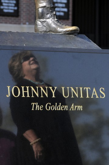 Sandy Unitas the wife of Johnny Unitas, looks at the statue of her husband that now stands next to the statue of Ray Lewis. (Lloyd Fox/Baltimore Sun)