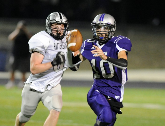 Patterson Mill's Adam Eberius chases down Joppatowne quarterback Kenny Baroch as he tries to make the throw during the football game at Edgewood on Friday, Sept. 19. (Staff photo by Matt Button, Baltimore Sun Media Group)