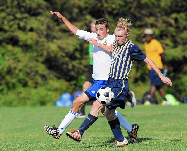 Aberdeen's Eric Peterson, left, and Perryville's Ryan Norris battle for ball control during a boys soccer game at Aberdeen Monday, Sept. 15. (Staff photo by Matt Button, Baltimore Sun Media Group)