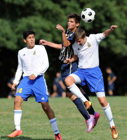 Aberdeen's Christopher Felts battles Perryville's Dillon Drouillard, right, as they go up to head the ball during a boys soccer game at Aberdeen Monday, Sept. 15. (Staff photo by Matt Button, Baltimore Sun Media Group)