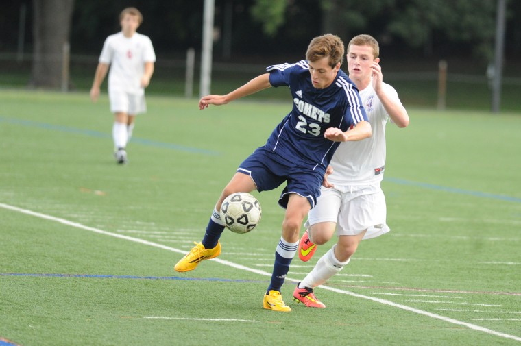 Catonsville's Mike Gagnon keep his body between the ball and Franklin opponent Reid Merlo, right, during a boys soccer game at Franklin High School Wednesday, Sept. 17. (Staff photo by Brian Krista, Baltimore Sun Media Group)