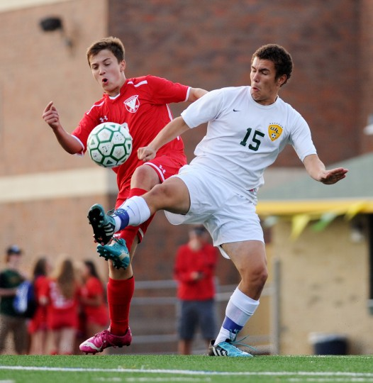 Centennial's Ammar Narmouq, left, and Wilde Lake's Ethan Miranda both go up for a shot at the ball during a boys soccer game at Wilde Lake High School in Columbia, Friday, Sept. 19, 2014. (Staff photo by Jon Sham, Baltimore Sun Media Group)