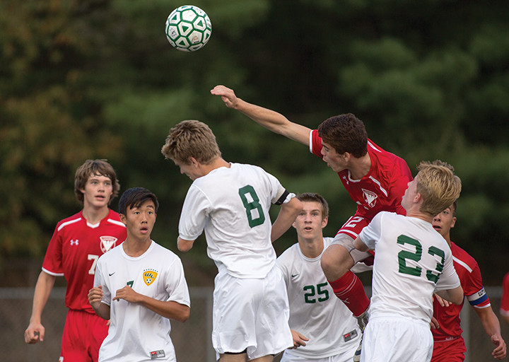 Ryan Maher, a defender from Centennial High School, wins a header over Wilde Lake senior Kevin Obrochte (8) during a boys soccer game on Friday, Sept. 19. (Photo by James Levin, Baltimore Sun Media Group)