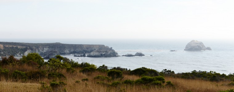 A wide shot of the ocean along the Pacific Coast Highway.