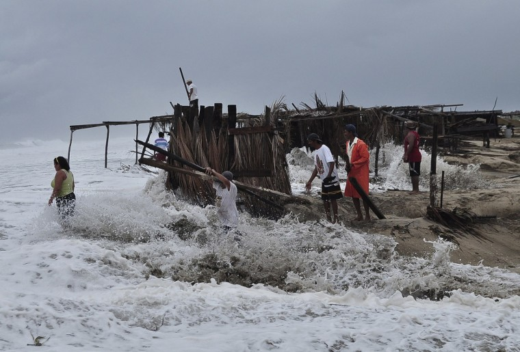 Residents recover pieces of wood after high waves dragged their beach stalls into the sea in Coyuca de Benitez, on the outskirts of Acapulco. Tropical Storm Polo is forecast to become a hurricane off Mexico's Pacific Coast on Thursday, the U.S. National Hurricane Center (NHC) said, just days after a severe storm battered the Baja California peninsula. As of Tuesday afternoon, Polo was about 260 miles (418 km) south of Mexico's beach resort of Acapulco and moving in a northwesterly direction at 12 miles per hour (19 km per hour), the NHC said. It added that the storm had maximum sustained winds of 45 mph, with some strengthening expected as it moves almost parallel along the southwestern coast of Mexico through Thursday. (Claudio Vargas/Reuters)