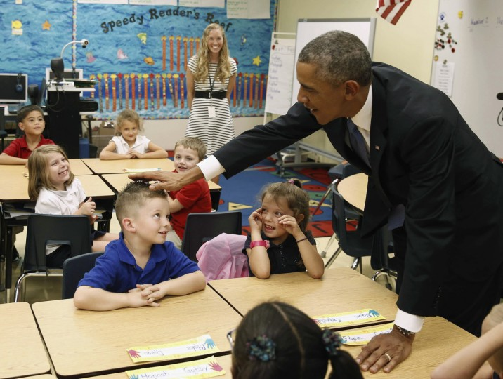 U.S. President Barack Obama touches the spiked hair style of a child while visiting the Clarence Tinker elementary school children while at MacDill Air Force Base in Tampa, Florida. (Larry Downing/Reuters)