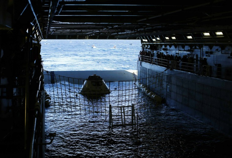 A test version of NASA's Orion capsule floats in the rear of the USS Anchorage during a recovery drill off the coast of California. Orion is NASA's next exploration spacecraft, designed to carry astronauts to destinations in deep space, including an asteroid and Mars. (Mike Blake/Reuters)
