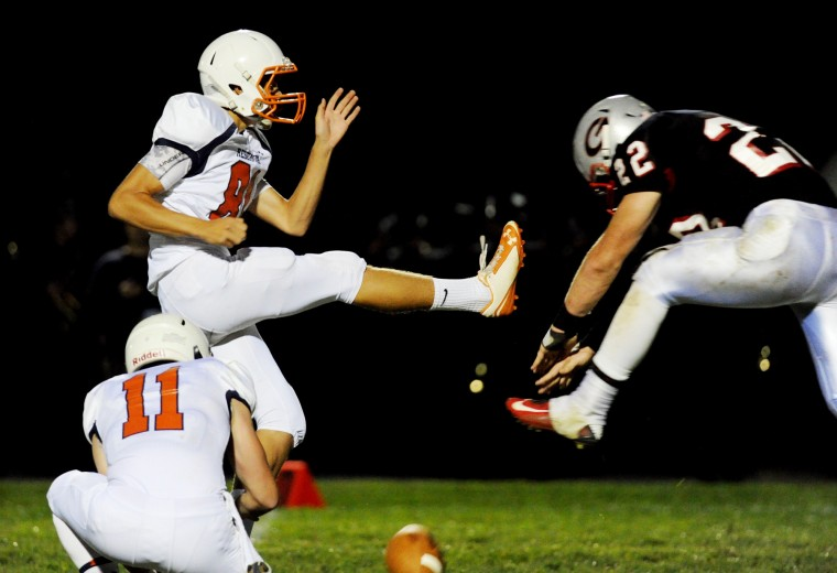 Glenelg's Matt Baxter, right, stuffs an extra point attempt from Reservoir kicker Zach Romer during a football game at Glenelg High School in Glenelg on Friday, Sept. 19. (Staff photo by Jon Sham, Baltimore Sun Media Group)