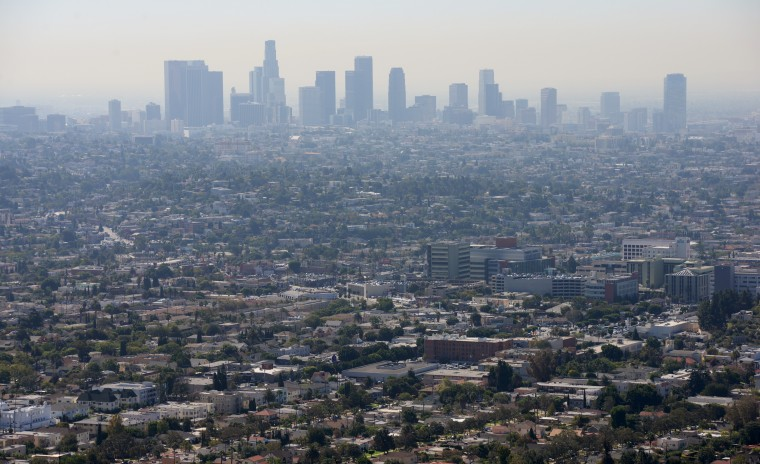 The city of Los Angeles can be seen from the Griffith Observatory, and even though there were no clouds in the sky, the smog made it appear otherwise.