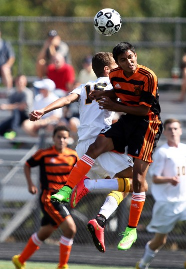Mt. Hebron sophomore Atticus Cooke fights for possession against Oakland Mills junior Mike Ahumada-Murillo. (Photo by Daniel Kucin Jr., Baltimore Sun Media Group)