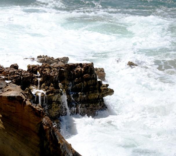 The waves crash on the shore at Laguna Beach, Tuesday, Aug. 26.