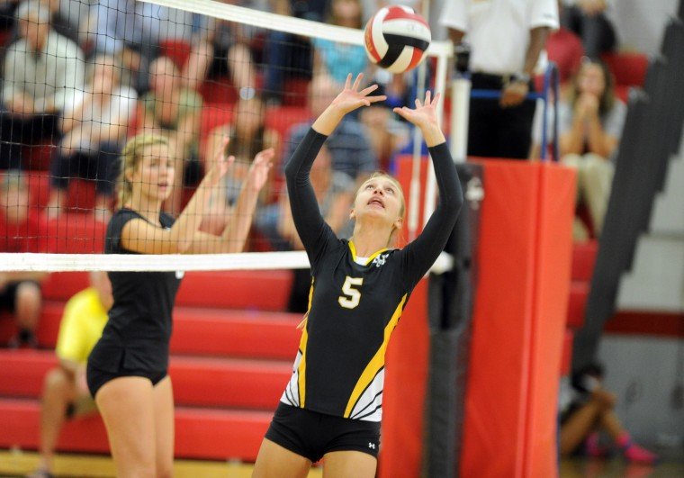 Mt. Hebron's Cheryl Dombrowski set the ball for a teammate during a girls volleyball match against Glenelg at Glenelg High School on Thursday, Sept. 18. (Staff photo by Brian Krista, Baltimore Sun Media Group)