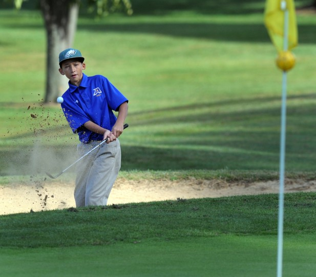 Aberdeen's Hunter Schiesser chips onto the green on the fourth hole during Tuesday's golf match with Edgewood and North Harford at Geneva Farm golf course. (Matt Button/BSMG)