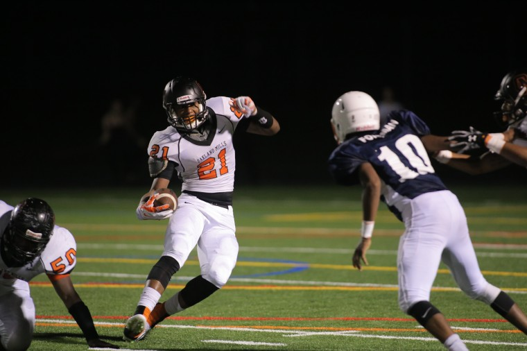 Oakland Mills sophomore Naquan Williams-Day, left, cuts back during a game against Reservoir on Friday, Sept. 26. (James Levin/BSMG)