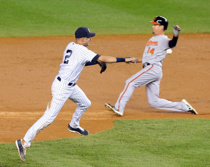 New York Yankees shortstop Derek Jeter (2) throws to first base as Baltimore Orioles second baseman Kelly Johnson (14) slides into second base during Jeter's final game at Yankee Stadium. (Brad Penner-USA TODAY Sports)