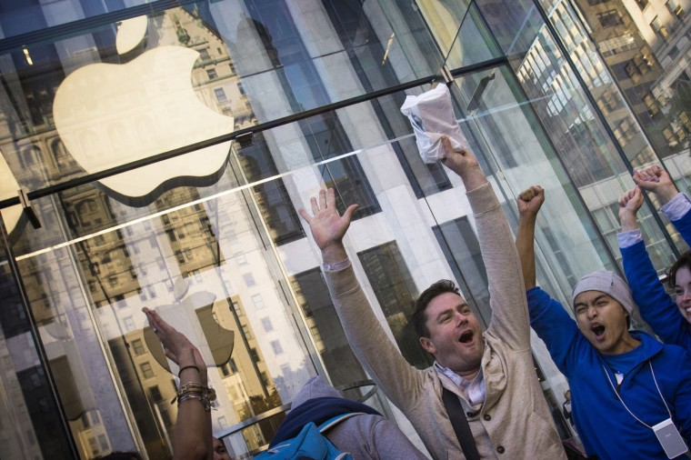 Local resident Andreas Gibson celebrates after being the first to exit the Fifth Avenue store after purchasing an iPhone 6 on the first day of sales in Manhattan, New York September 19, 2014. Adrees Latif/Reuters photo