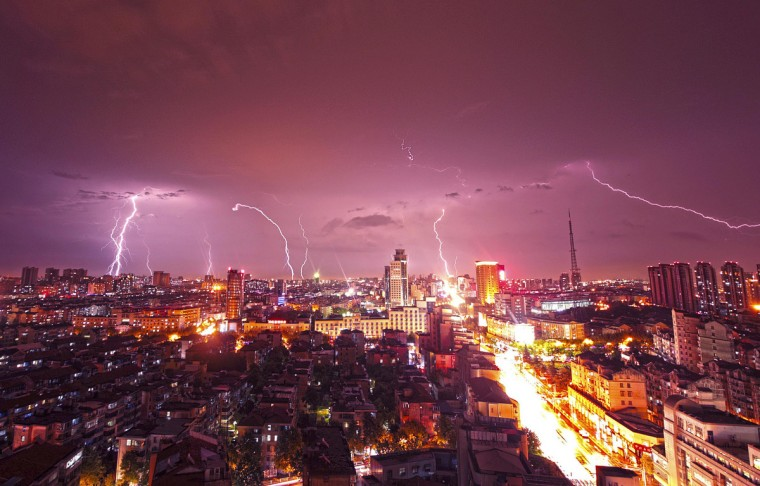 Lightning strikes over buildings during heavy rainfall in Kunshan, Jiangsu province. (Reuters)