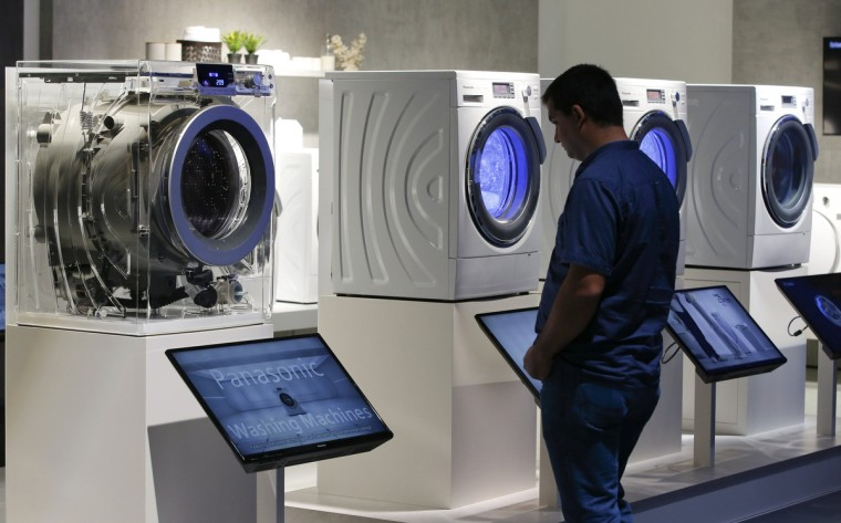 A visitor looks at Panasonic washing machines during the IFA consumer technology fair in Berlin, September 5, 2014. (Fabrizio Bensch/Reuters)