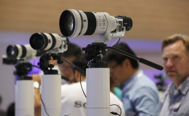 Sony camera lenses with attached lens-like cameras ILCE-QX1 with 20.1MP sensors are pictured at the IFA consumer technology fair in Berlin, September 5, 2014. (Fabrizio Bensch/Reuters)