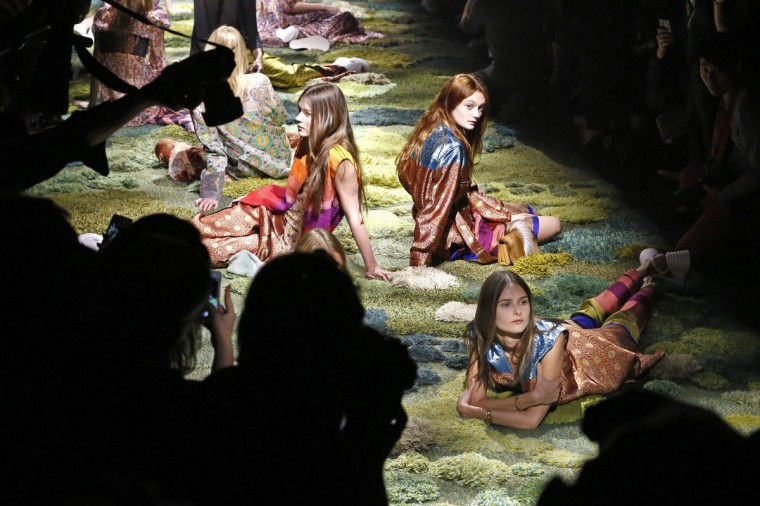 Models sit on the catwalk as they present creations at the end of Belgian designer Dries Van Noten Spring/Summer 2015 women's ready-to-wear collection show during Paris Fashion Week. (Charles Platiau/Reuters)