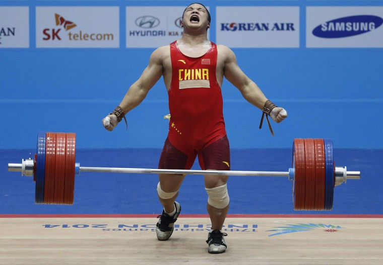 China's Liu Hao reacts after winning the gold medal with a lift of 221kg on his third attempt in the men's clean and jerk 94kg weightlifting competition at the Moonlight Garden Venue during the 17th Asian Games in Incheon September 25, 2014. (REUTERS/Olivia Harris)