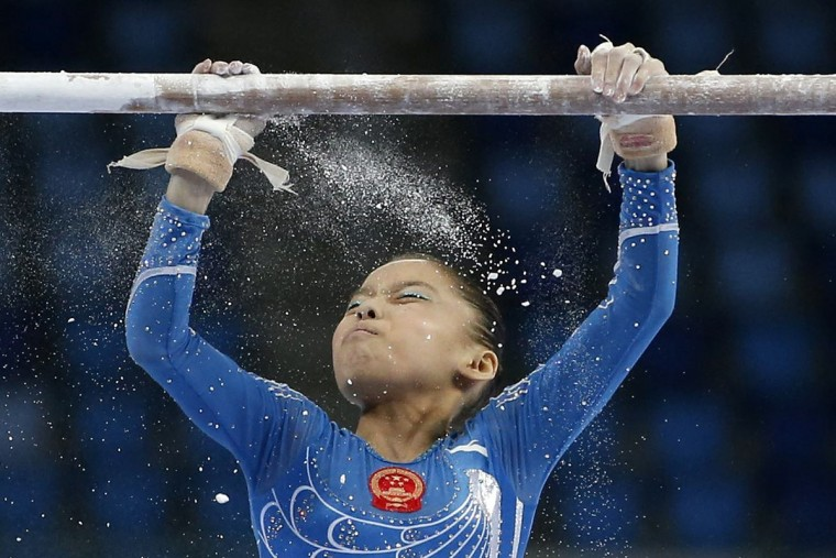 China's Shang Chunsong prepares to compete in the uneven bars event of the women's individual all-around final artistic gymnastics competition at the Namdong Gymnasium Club during the 17th Asian Games in Incheon September 23, 2014. (Kim Hong-Ji/Reuters)