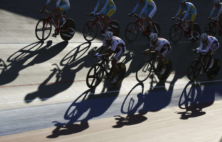 Qatari and Kazakhstan track cyclists train at the Incheon International Velodrome ahead of the 17th Asian Games September 18, 2014. (Olivia Harris/Reuters)