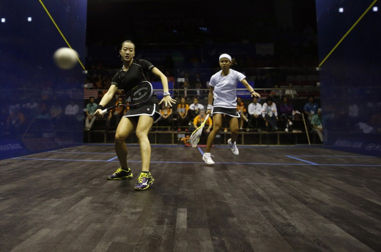 Malaysia's Nicol David (R) competes against her compatriot Low Wee in their women's single squash match final at the Yeorumul Squash Courts during the 17th Asian Games in Incheon September 23, 2014. (Issei Kato/Reuters)