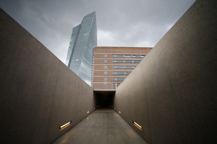 The entrance to the cellars of the former market hall 'Grossmarkthalle' is pictured across a concrete ramp, part of a holocaust memorial at the site of the new European Central Bank (ECB) headquarters in Frankfurt, September 11, 2014. The Grossmarkthalle is integrated into the office complex of the new ECB. The memorial commemorates about ten thousand victims of the holocaust who have been deported from October 1941 until March 1945 by the Nazi regime that used the Grossmarkt cellars as an assembly point for deported Jews. REUTERS/Ralph Orlowski