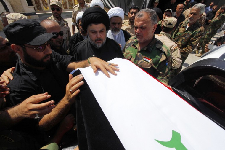 Radical Shi'ite cleric Muqtada al-Sadr (C) attends the funeral of fighters loyal to his Brigades of Peace, who were killed when an improvised explosive device (IED) exploded near the town of Amerli, during their funeral in Najaf, south of Baghdad. (Alaa Al-Marjani/Reuters)