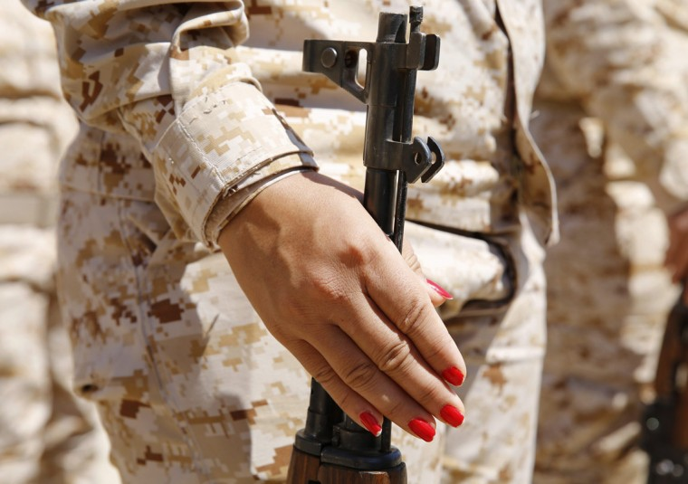 The painted nails of a Kurdish Peshmerga female fighter are seen as she holds her gun during combat skills training before being deployed to fight Islamic State militants, at their military camp in Sulaimaniya, northern Iraq September 18, 2014. (Ahmed Jadallah/Reuters)