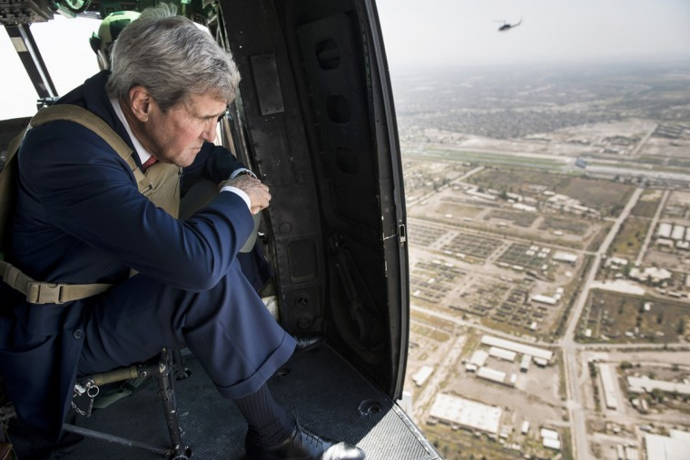 U.S. Secretary of State John Kerry looks out over Baghdad from a helicopter September 10, 2014. Kerry arrived in Baghdad on Wednesday as he began a tour of the Middle East to build military, political and financial support to defeat Islamic State militants controlling parts of Iraq and Syria. (Brendan Smialowski/Pool/Reuter)