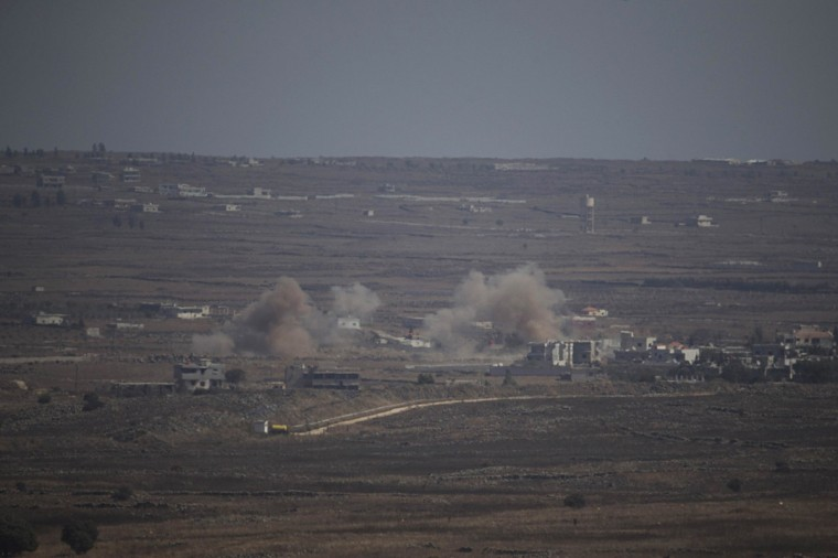 Smoke rises following explosions in Syria near the border with the Israeli occupied Golan Heights September 23, 2014. Israel shot down a Syrian warplane on Tuesday, saying the aircraft crossed the battle lines of Syria's civil war and flew over the Israeli-held Golan Heights, perhaps by accident. (Baz Ratner/Reuters)