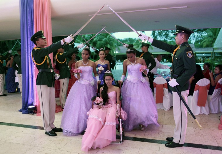 "Female cancer patients take part in their ""Quinceanera"" (15th birthday) party at a hotel in Managua September 20, 2014. A quinceanera is a traditional celebration for a girl turning 15. The Nicaragua's Association of Mother and Father of Children with Leukemia and Cancer (MAPANICA) organizes quinceaneras for cancer patients annually, and there were 44 celebrants in 2014. Picture taken September 20, 2014. (Oswaldo Rivas/Reuters)"