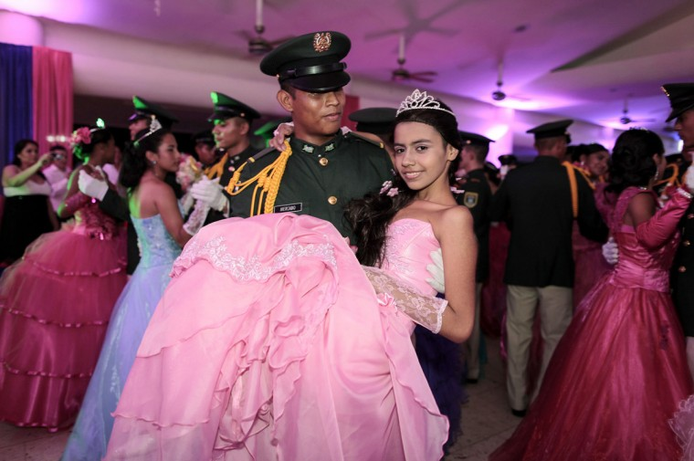 "A cancer patient dances with a cadet from Nicaragua's Military Academy during her ""Quinceanera"" (15th birthday) party at a hotel in Managua September 20, 2014. A quinceanera is a traditional celebration for a girl turning 15. The Nicaragua's Association of Mother and Father of Children with Leukemia and Cancer (MAPANICA) organizes quinceaneras for cancer patients annually, and there were 44 celebrants in 2014. Picture taken September 20, 2014. (Oswaldo Rivas/Reuters)"