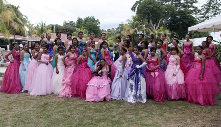 "Female cancer patients pose for a group photo during their ""Quinceanera"" (15th birthday) party at a hotel in Managua September 20, 2014. A quinceanera is a traditional celebration for a girl turning 15. The Nicaragua's Association of Mother and Father of Children with Leukemia and Cancer (MAPANICA) organizes quinceaneras for cancer patients annually, and there were 44 celebrants in 2014. Picture taken September 20, 2014. (Oswaldo Rivas/Reuters)"