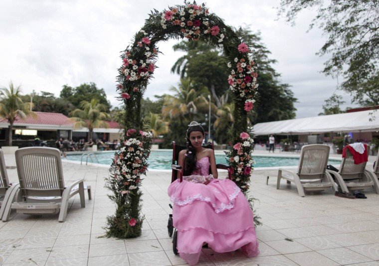 "A cancer patient poses for a photo during her ""Quinceanera"" (15th birthday) party at a hotel in Managua September 20, 2014. Quinceaneras are a traditional celebration for girls turning 15. The Nicaragua's Association of Mother and Father of Children with Leukemia and Cancer (MAPANICA) organizes quinceaneras for cancer patients annually, and there were 44 celebrants in 2014. Picture taken September 20, 2014. (Oswaldo Rivas/Reuters)"
