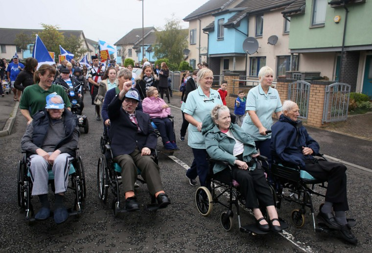 "Residents take part in a ""short walk to freedom"" march in Edinburgh, Scotland September 18, 2014. Polling in the referendum on Scottish independence began on Thursday morning, as Scotland votes whether or not to end the 307-year-old union with the rest of the United Kingdom. (Paul Hackett/Reuters)"