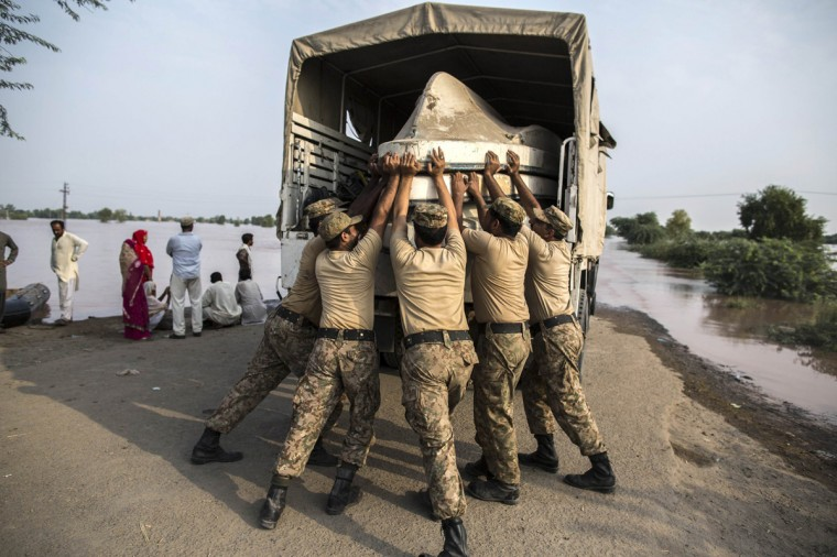 Army soldiers unload boats to be used for evacuating flood victims from their flooded houses following heavy rain in Jhang, Punjab province, September 10, 2014. The prime ministers of India and Pakistan have offered to help each other in efforts to alleviate flood havoc in the disputed Himalayan region of Kashmir, lowering tension between the rival nations after weeks of army clashes and heated rhetoric. (Zohra Bensemra/Reuters)
