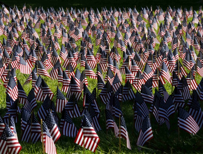 A view shows a portion of the 2,977 flags laid out to signify the people who lost their lives in the 9/11 attacks in New York, Washington, D.C., and Shanksville, Pennsylvania, during a remembrance event on the campus of Cuyamaca College in El Cajon, California September 11, 2014. Today is the thirteenth anniversary of the 9/11 attacks on New York, Washington, and Pennsylvania. REUTERS/Mike Blake