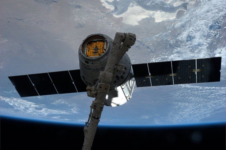 """The SpaceX Dragon commercial cargo spacecraft is grappled to Canadarm2 at the International Space Station in this NASA picture taken April 20, 2014. NASA will partner with Boeing and SpaceX to building commercially owned and operated """"space taxis"""" that would fly astronauts to the International Space Station ending U.S. Dependence on Russia for rides, U.S. Senator Bill Nelson said September 16, 2014. (NASA/Handout via Reuters/Reuters)"""