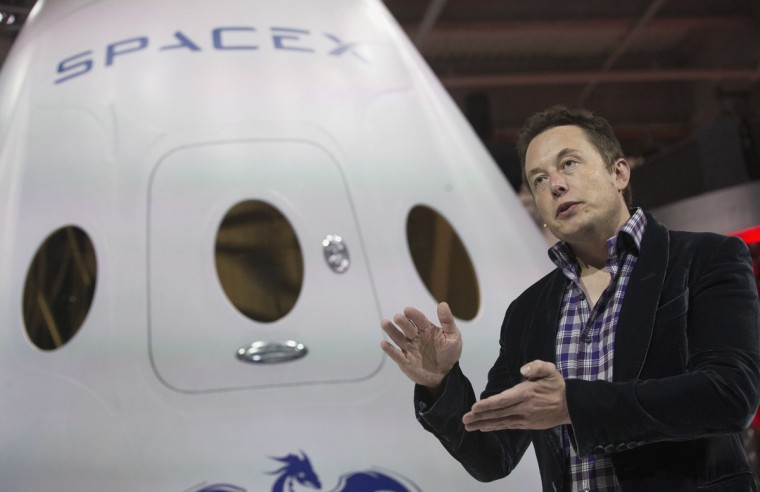 """SpaceX CEO Elon Musk speaks after unveiling the Dragon V2 spacecraft in Hawthorne, California in this May 29, 2014 file photo. NASA will partner with Boeing and SpaceX to building commercially owned and operated """"space taxis"""" that would fly astronauts to the International Space Station ending U.S. Dependence on Russia for rides, U.S. Senator Bill Nelson said September 16, 2014. (Mario Anzuoni/Files/Reuters)"""