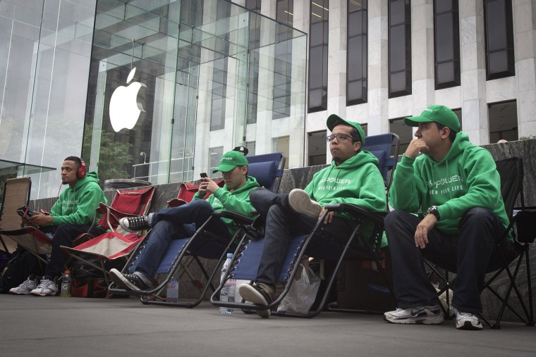 People line up outside the Apple Store in advance of an Apple special event, in the Manhattan borough of New York September 9, 2014. Carlo Allegri/Reuters photo