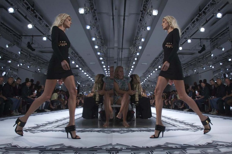 A model is reflected in a mirror as she presents a creation during the Versus Versace Spring/Summer 2015 collection show during New York Fashion Week in the Manhattan borough of New York September 7, 2014. (Carlo Allegri/Reuters)