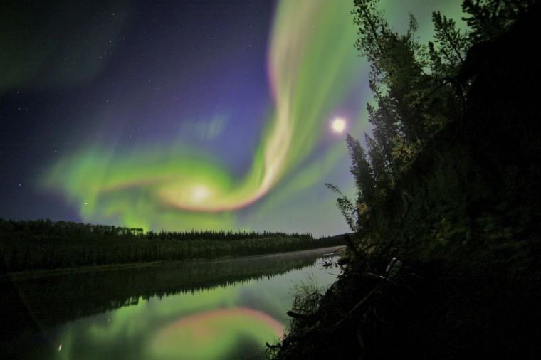 Swirls of green and red appear in an aurora over Whitehorse, Yukon on the night of September 3, 2012 in this NASA handout image. Stargazers across a wide swath of the United States could get a rare view on September 12, 2014 of the northern lights, a colorful cosmic display normally only visible in far northern latitudes. (Courtesy of David Cartier, Sr./NASA)
