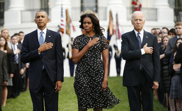 (L to R) U.S. President Barack Obama, U.S. first lady Michelle Obama and Vice President Joe Biden observe a moment of silence on the 13th anniversary of the 9/11 attacks at the White House in Washington September 11, 2014. Politicians, dignitaries and victims' relatives were gathering in New York, Washington and Pennsylvania on Thursday to commemorate the nearly 3,000 people killed in al Qaeda's attack on the United States 13 years ago on Sept. 11. REUTERS/Kevin Lamarque