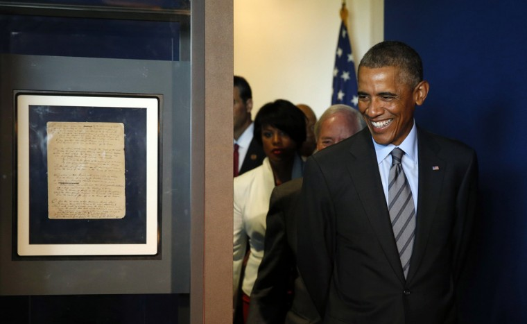 "U.S. President Barack Obama arrives to look at a copy of the original manuscript of Francis Scott Key's ""The Star Spangled Banner"" (L) at Fort McHenry in Baltimore, Maryland September 12, 2014. This weekend marks the 200th anniversary of the writing of ""The Star-Spangled Banner."" (Kevin Lamarque/Reuters)"