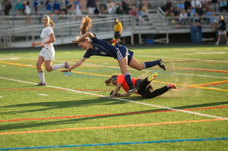 Howard's goalie Marisa Grant, bottom, takes out River Hill's Zoe Smedley as she runs after the ball during a girls soccer game at Howard High Tuesday, Sept. 16. (Photo by Nate Pesce, Baltimore Sun Media Group)