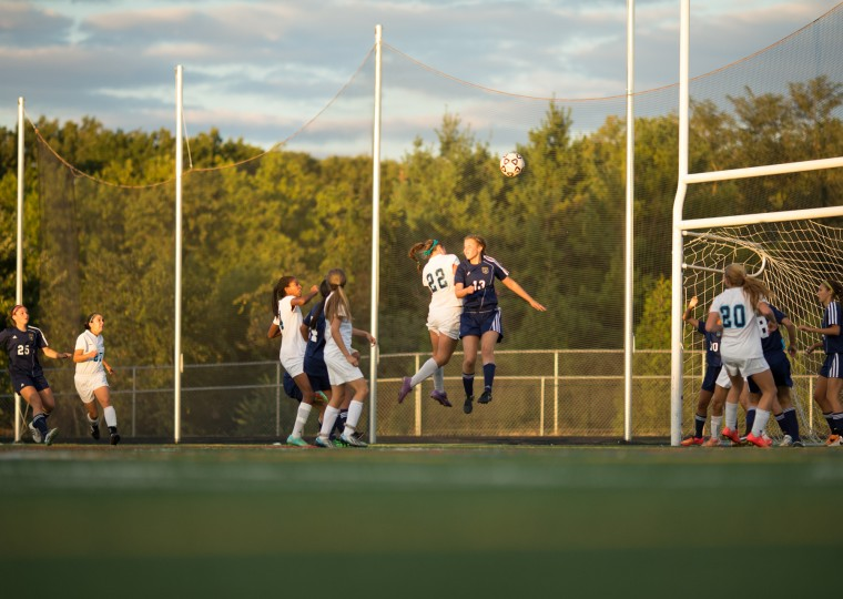 Howard's Catherine Sims (#22), center left, and River Hill's Jennifer Voyton (#13) both jump trying to regain control of the ball during a girls soccer game at Howard High on Tuesday, Sept. 16. (Photo by Nate Pesce, Baltimore Sun Media Group)